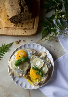 Gluten free bread with fired eggs, goat cheese and basil.