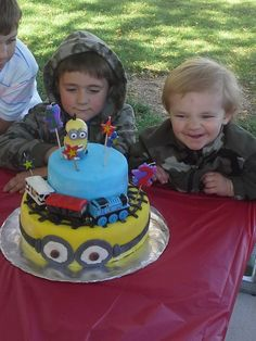 Perfect cake... Thomas the Train and Minions! 2 year old and 5 year old combine birthdays