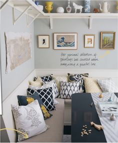 Love this--shelving above, pictures inbetween, and most of all the seating :)  kitchen someday
