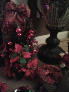 Red flowers on christmas tree and plaid bow.