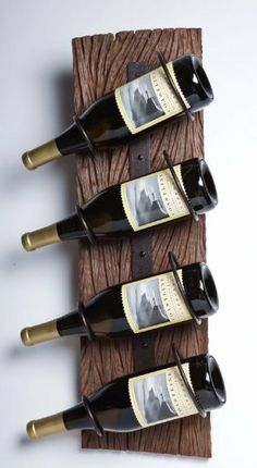 """4-Wine Bottle Wood and Metal Wall Holder by Accent Your Life. $69.99. 8""""L x 6""""W x 24""""H. From the Cape Craftsmen Everyday Retro Collection. Great for yourself or as a gift. Made of Recycled wood and metal. Hanging Display. The wine bottle hanging display that will mystify your guests. This wine bottle holder is equipped with four sets of metal loops to rest your bottles in and use as a chic wall hanger. Both useful and decorative, this item is great for any hom..."""