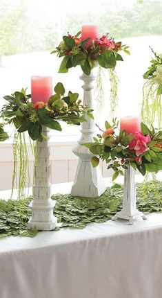 For the table, dress up pillar candles with the Chloe Candle Ring Set. These small wreaths of lifelike flowers, greenery, and berries add romance and a sense of occasion. Try elevating them on tall candlesticks to let the greenery drape gently. Wedding Table Centerpieces, Wedding Flower Arrangements, Floral Centerpieces, Floral Arrangements, Wedding Flowers, Wedding Decorations, Table Decorations, Centerpiece Ideas, Kitchen Table Centerpieces