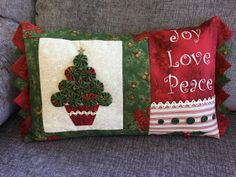 Decorate your home with this delightful Christmas cushion. Measuring 25.5cm x 40.5cm  (10in x 16in), not including the Prairie Points, it is quick and simple to make and will enhance your festive occasion. Val Laird Designs