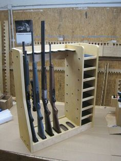 Quality rotary gun racks used to store rifles, rifles with scopes and shot guns on a rotating gun rack for easy access. Quality pistol racks include single level pistol racks and double level pistol racks for the sportsman, gun collector and dealer Gun Closet, Rifle Rack, Reloading Room, Ammo Storage, Hidden Storage, Craft Storage, Shooting Bench, Hidden Gun, Gun Rooms