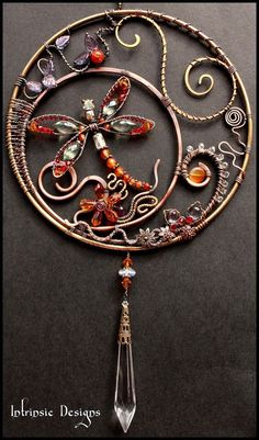 Gemstone and Crystal Dragonfly Suncatcher by Cathy Heery ...pretty sure i could make something similar. I've already got the wire and beads/crystals. I just need a trip to the craft store to get the thick wire structures that make up the foundation: