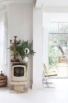 Wood burner in a lovely London home / Light Locations.