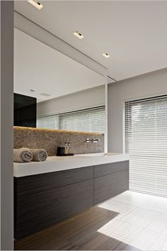 Elegant tones and lines, bathroom by Eletech Prestige Kappelen _