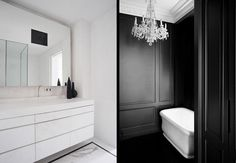 Black walls and a chandelier in a bathroom.  The crown moulding in a nice crisp white.