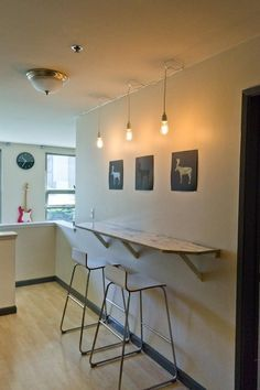 I have used this solution for an extremely slim kitchen in a very small studio apartment.