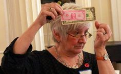 To Solve the Gender Wage Gap, Learn to Speak Up - NYTimes.com (pictured: Annie Houle of the WAGE Project uses dollar bills and play money to show men's pay advantage over different groups of women. Her program teaches women how to negotiate for better salaries.)