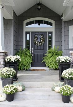 FALL FRONT PORCH DECOR // mum and pumpkins // farmhouse decor // Fall decorations // neutral Fall decor // white mums // farmhouse inspiration Decor Style Home Decor Style Decor Tips Maintenance Mums In Pumpkins, White Pumpkins, White Mums, Halls, Farmhouse Front Porches, Front Door Decor, Front Porch Fall Decor, Planters For Front Porch, Fall Front Porches