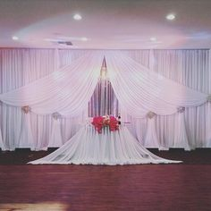 Throw back Thursday to this amazing draping by @pearlsia_decor. Thank you for all of your hard work for our brides! #wedgewoodweddings #ivorydraping #chandelier #romanticwedding #weddinginspiration