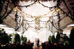 Unadorned pine trees inside. I LOVE this! Not the pin garlands, just the trees. (Ruffled - Wedding Photographer: Alison Conklin - http://ruffledblog.com/enchanted-forest-wedding/)