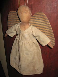 SCHNEEMAN Angel, Signed and Dated 1997, Old Ticking Wings, Early Fabric Gown, 1 Tiny bead eye missing (Easy to fix), 12in.Tx10in.W., $145.00 plus mailing.