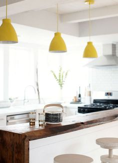 These pendant lights instantly brighten this kitchen space