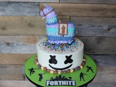 Fortnite Cake with a Rice Krispie Loot Llama and custom Fortnite cake board from Kaylin Jones Cupcakes