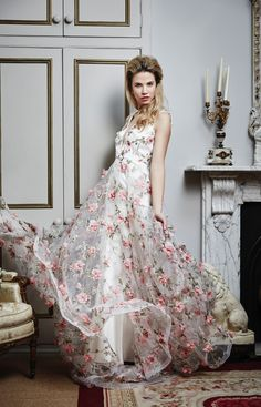 Flora, Savin London. Gorgeous floral dress from Savin London with embroidered bodice and appliqué florals on the skirt #floral #embroidered #wedding #dress