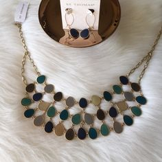 Statement Necklace Beautiful gold set that was purchased and never used necklace retails for $95 and earrings for $38 both make a wonderful statement, will be shipped in it's own git box. St Thomas Jewelry Necklaces