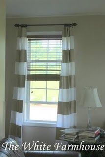 painted curtains. love the idea of beige and white stripes.