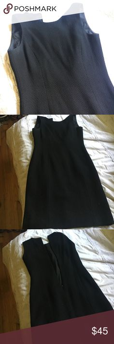 Ann Taylor wool black dress Ann Taylor wool black dress - worn with love, a very small section has slight discoloration but not noticeable and could come out with dry cleaning. Perfect for work, open to offers! Ann Taylor Dresses Midi