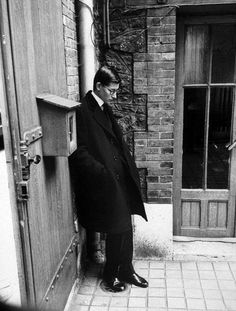 Yves Saint Laurent standing alone after attending Christian Dior's funeral © Loomis Dean, Paris, Oct. 1957.
