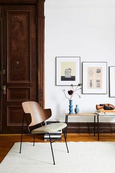 Framed art on wall over contemporary winged back chair