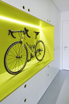 Bike storage and polyurethane floors in hallway of Prague guest apartment by Mjölk and DDAANN. Cycle Storage, Bike Storage Rack, Garage Storage, Bike Wall, Bike Room, Garage Velo, Bike Storage Apartment, Bike Storage Solutions, Storage Ideas