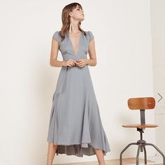 Reformation Laura dress in Fresh Air NWOT Wind machine sold separately. This is a calf length, wrap dress with a very low neck and cap sleeve. Absolutely stunning  - Calf length- Cap sleeve- Fitted bodice- Not bra friendly- Very low v neck- Wrap dress Reformation Dresses Wedding