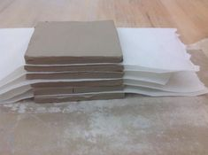 Stack pieces with paper in between them. Allow pieces to become leather hard before building.