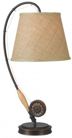 Fishing fans will love Kenroy Home's Fly Rod Table Lamp in a den, cabin, or anywhere a touch of angler style is needed. The curved fishing rod base supports a textured straw shade with braided trim; an oil rubbed bronze finish is the perfect complement. Fishing Bedroom, Fishing Nursery, Boys Fishing Room, Hunting Bedroom, Fly Fishing Rods, Fly Rods, Fishing Table, Camping Lights, Family Room Design