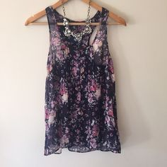 BCBG dark blue sheer flower tank Light and button down airy tank. I cut the size off but fits like a small. BCBGMaxAzria Tops Tank Tops