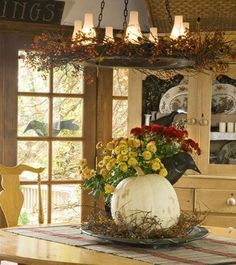 The Wheel Deal: Dressed up with orange berries, a wagon-wheel chandelier that Kathleen\