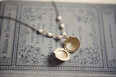 Shell locket necklace with white freshwater pearls  by InmostLight, $26.00