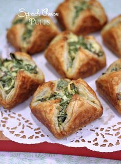 Spinach Bacon Cheese Puffs * * *  4 ounces softened cream cheese, 1 large egg, 1 tablespoon olive oil, 2 packed cups chopped fresh spinach, 3/4 cup crumbled feta, 3 slices crumbled crispy cooked bacon, salt and pepper, 1 sheet frozen puff pastry (thawed and cut into 9 squares), 1 tablespoon melted butter