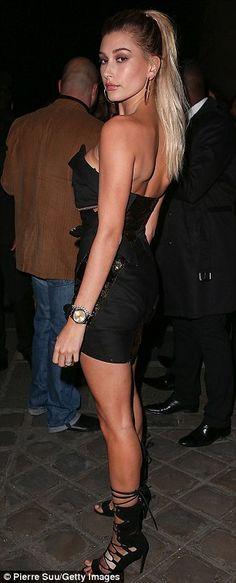 Stay golden! Hailey Baldwin donned an asymmetric LBD for the L'Oréal Gold Obsession bash at Monnaie de Paris on Sunday evening