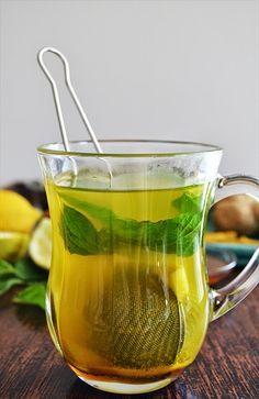 Healthy ginger tea with mint, honey, turmeric and lemon - shewandersshefinds.com