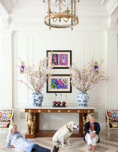 Kirsten Fitzgibbons & Kelli Ford - white walls with moulding, antique console, Matisse prints, ikat upholstered Louis chairs, blue and white ginger jars, stone floors
