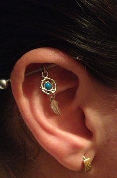 My dreamcatcher industrial bar piercing <3