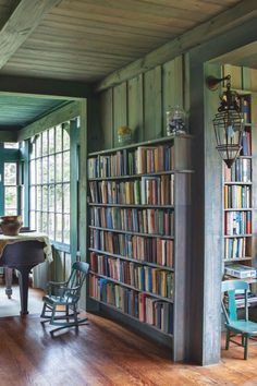 """The house's original wall color an intriguing, weathered blue-green, is unchanged. Jim's grandmother """"specified the stain herself, a mix of Prussian blue, yellow ochre, linseed oil, and turpentine,"""" according to The Maine House."""