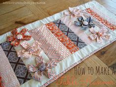 Free Tutorial: How to Make a Table Runner with Fabric Flowers from http://www.adventuresofadiymom.com/