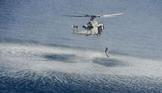 Naval Aircrewman (Helicopter) 3rd Class Mitchell D. Crowther, from Perryville, Md., leaps into the water from a MH-60S Sea Hawk helicopter assigned to the Sea Knights of Helicopter Sea Combat Squadron (HC) 22 embarked aboard the amphibious assault ship USS Bataan (LHD 5). Bataan is the flagship for the Bataan Amphibious Ready Group and, with the embarked 22nd Marine Expeditionary Unit, is deployed in support of maritime security operations and theater security cooperation efforts in the U.S. ...