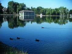 A view of Washington Park in Denver, Colorado, including the Smith's Lake and Boat House. The boat house was built by J.B. Benedict in 1913 following the Italian style of architecture. The park and the surrounding neighborhood, also called Washington Park, are listed on the National Register of Historical Places.