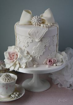 Romantic rose, lace and pearl wedding cake