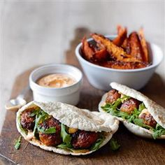 Spicy pork meatball pittas with harissa mayo and sweet potato wedges- this looks yummy... Just ignore the calorie count!