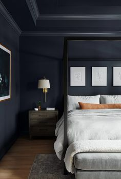 By painting the walls, trim and ceiling the same Benjamin Moore Temptation color, we elevated this room, adding a level of drama and sophistication and creating a unique, modern space for these clients. Dark Master Bedroom, Dark Blue Bedrooms, Dark Bedroom Walls, Blue Rooms, Master Bedroom Design, Home Bedroom, Modern Bedroom, Bedroom Decor, Bedroom Ideas