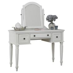 Offering an elegant space to store jewelry and cosmetics, this 3-drawer vanity showcases classically turned legs and a tilting beveled mirror. ...