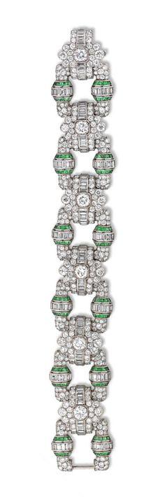 An important Art Deco emerald and diamond open panel bracelet, the bracelet…