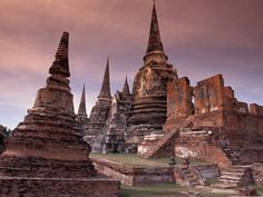 "Ruins of Ayutthaya (Thailand)  Ayutthaya, whose name means ""undefeatable"" in Sanskrit"