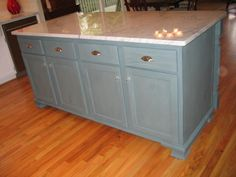 """Two stock cabinets from Lowe""""s. Added molding hand carved legs and block panel. Milk paint (French Gray Hand rubbed two coats tung oil. Carrea marble top 1 1/2 inch thick."""