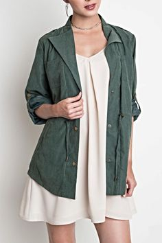 Lightweight jacket with drawstring at waist. Option to roll sleeves to 3/4 length. Looks awesome with denim greys browns and black on bottom. Can also be worn over a camisole or dress as pictured.  Military Style Jacket by Umgee USA. Clothing - Jackets Coats & Blazers - Jackets Chicago Illinois